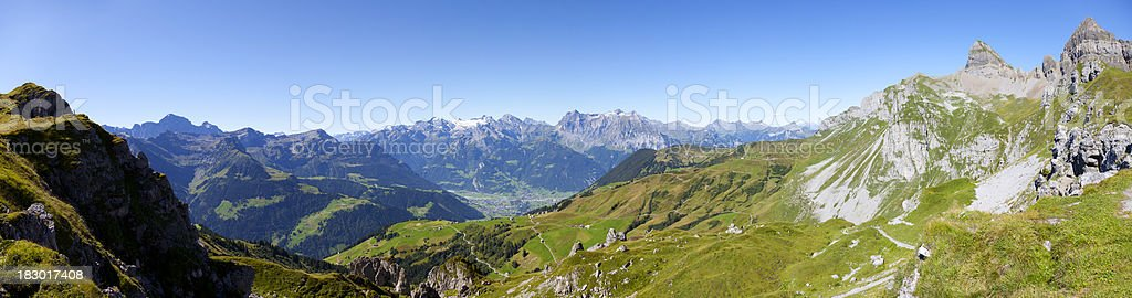 Scenic Swiss Mountain Panorama with Peaks and Hiking Trail stock photo