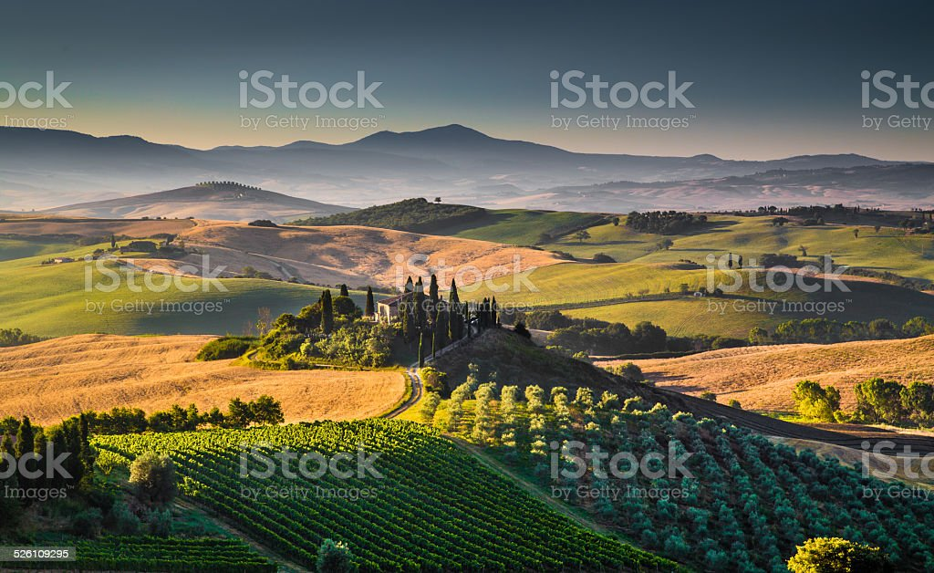 Scenic Tuscany landscape at sunrise, Val d'Orcia, Italy stock photo