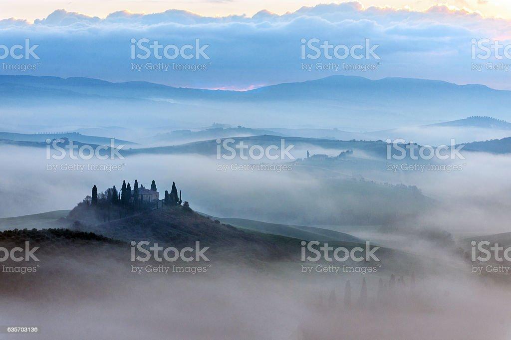 Scenic Tuscany landscape at sunrise, Val d'Orcia, Italy stock photo