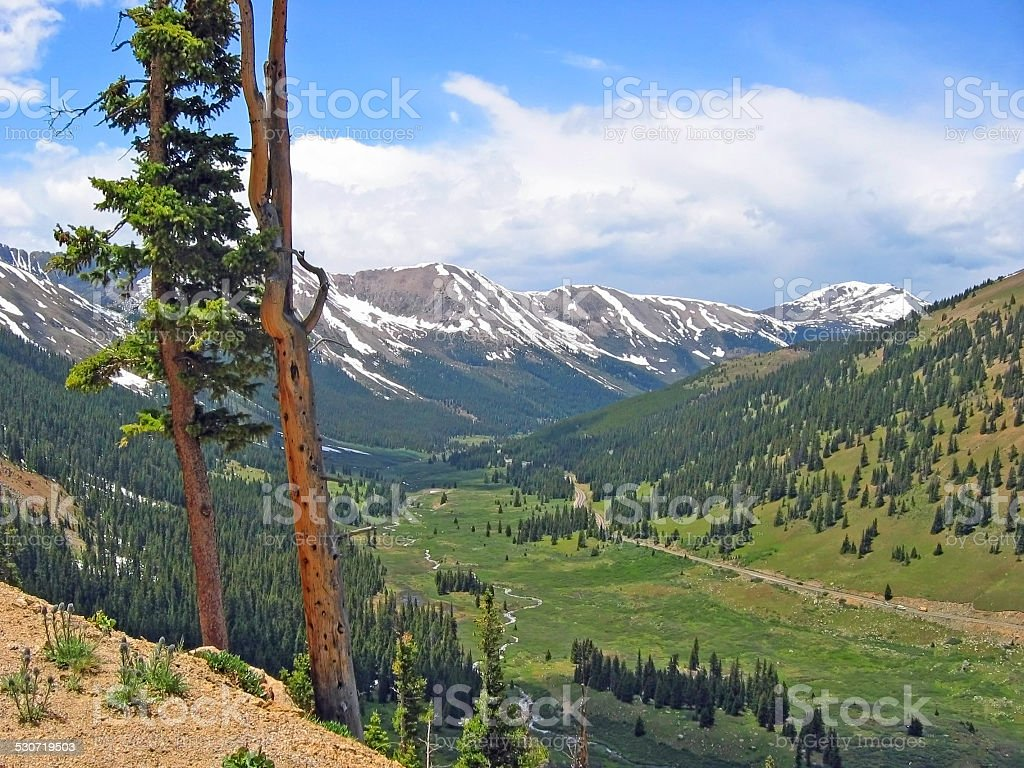 Scenic Valley in Majestic Mountains stock photo
