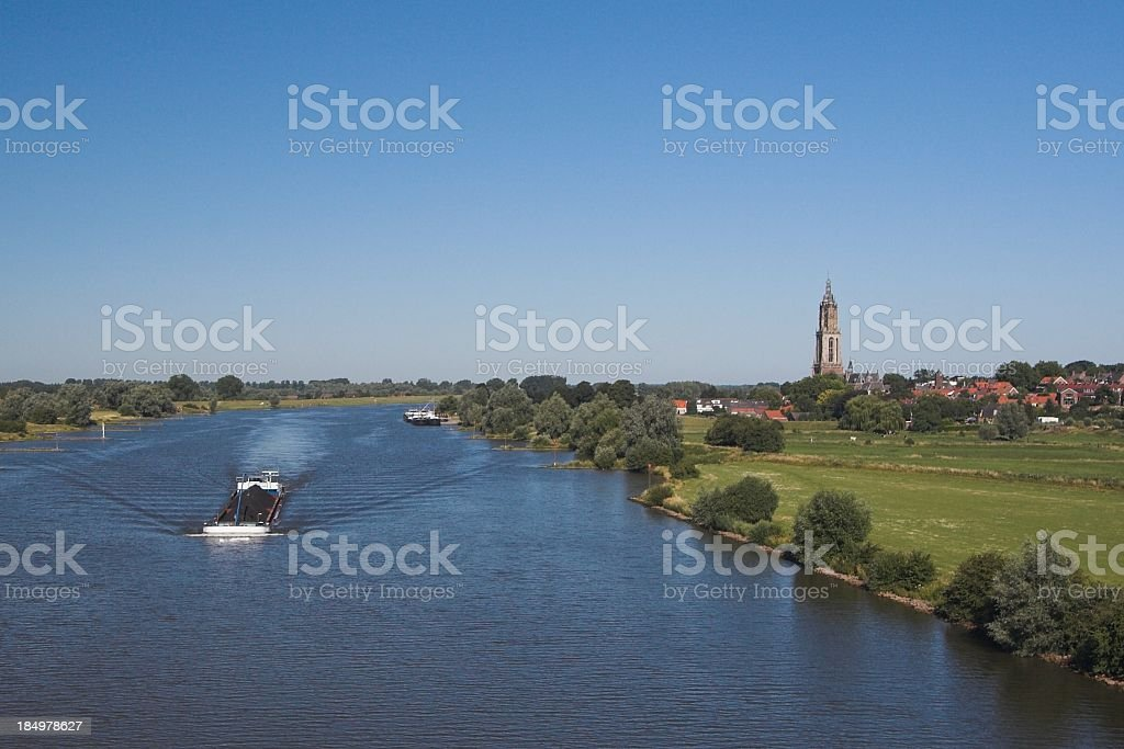 A scenic view of a Dutch village along side of Rhine river  royalty-free stock photo