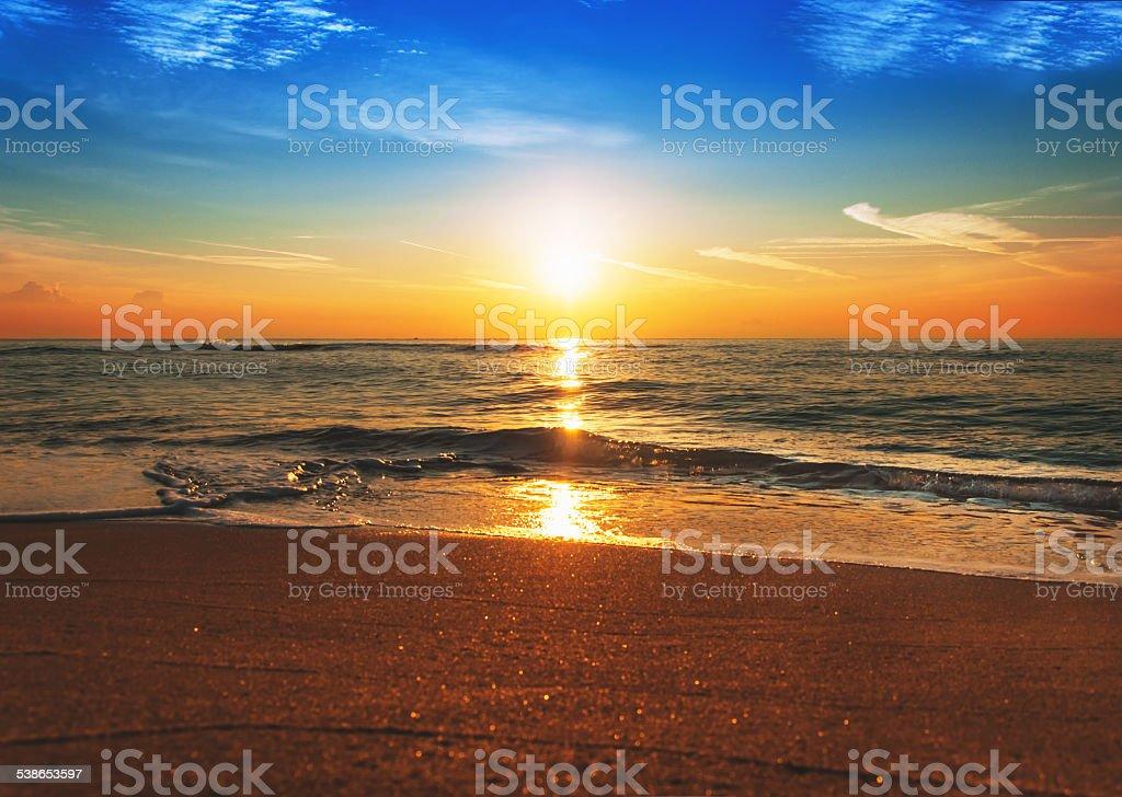 Scenic view of beautiful sunrise above the sea. stock photo