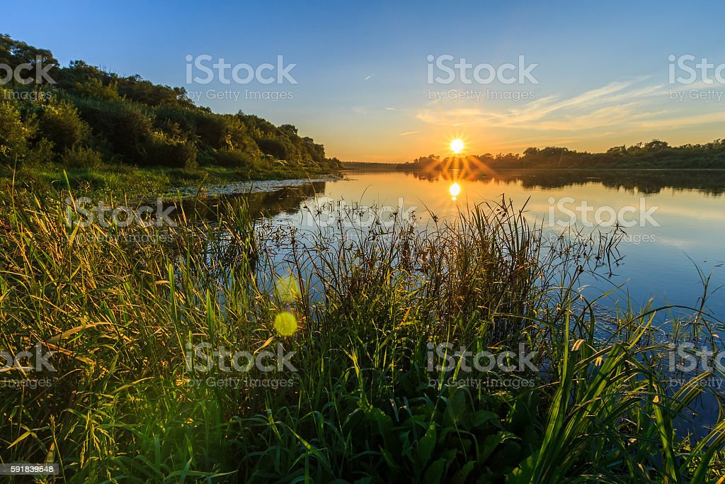 Scenic view of beautiful sunset above the river at summer stock photo