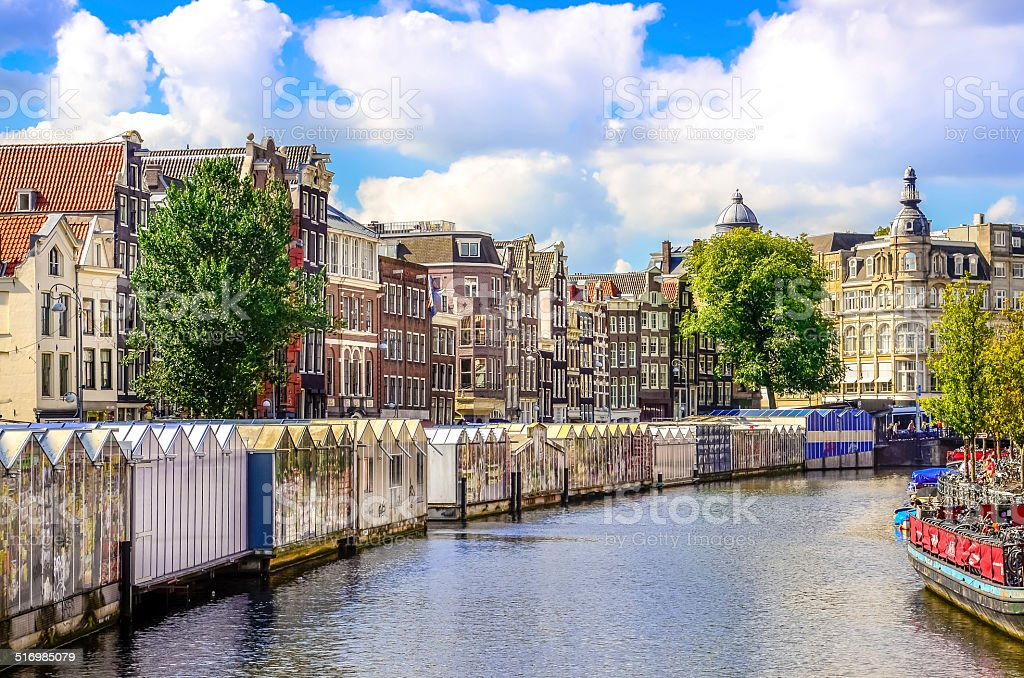 Scenic view of canal in Amsterdam at flower market stock photo