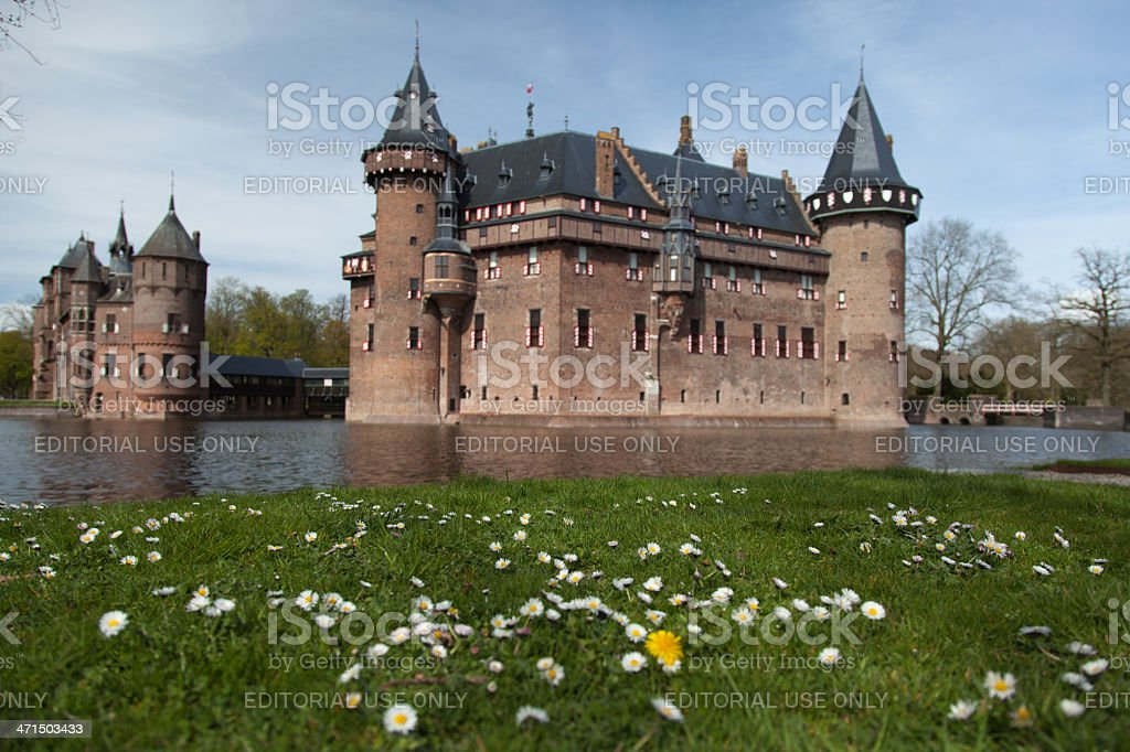 Scenic view of castle with daisies in foreground royalty-free stock photo