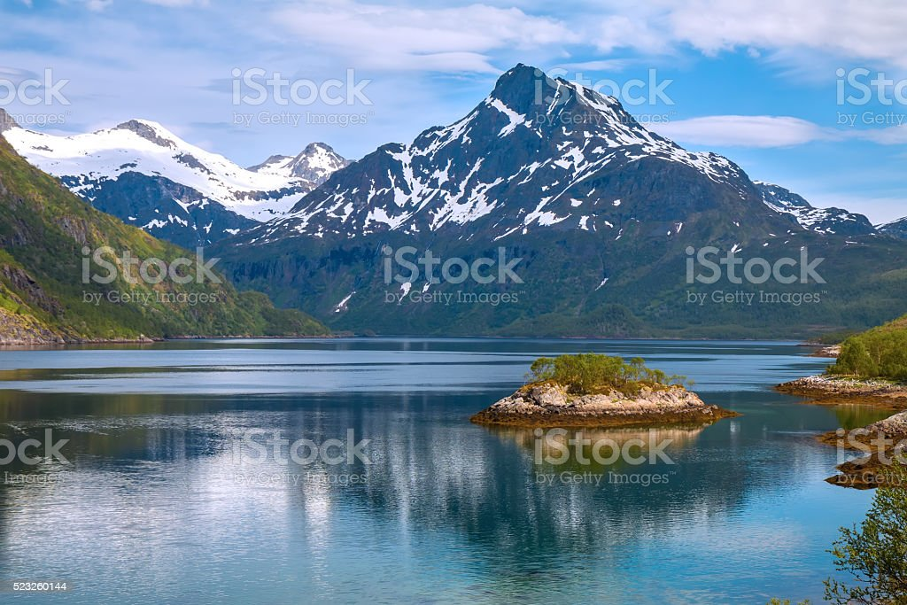 scenic view of fjord and snow mountains, Norway stock photo