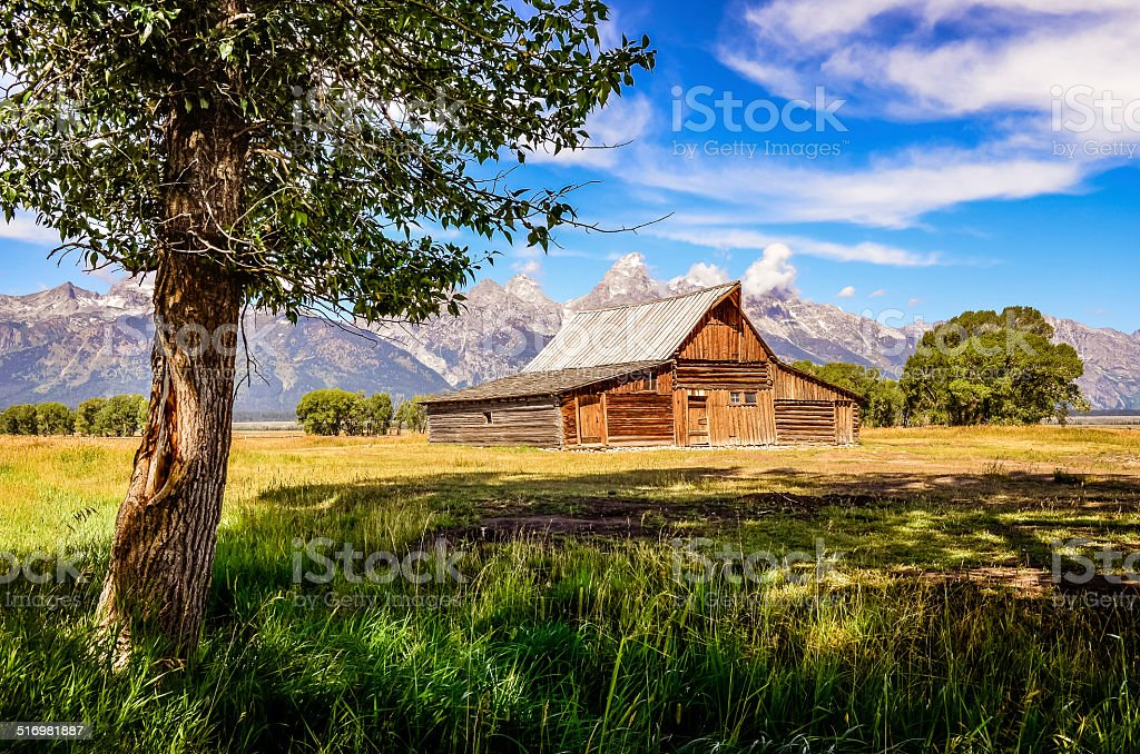 Scenic view of Grand Teton with old wooden farm stock photo