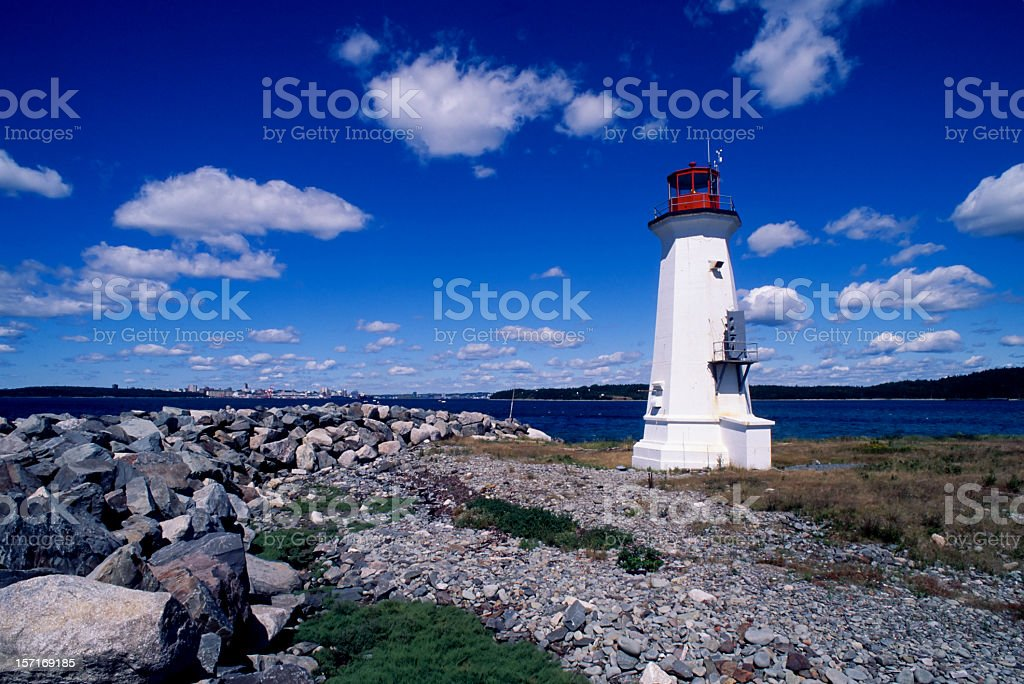 A scenic view of Maugher Beach Lighthouse stock photo