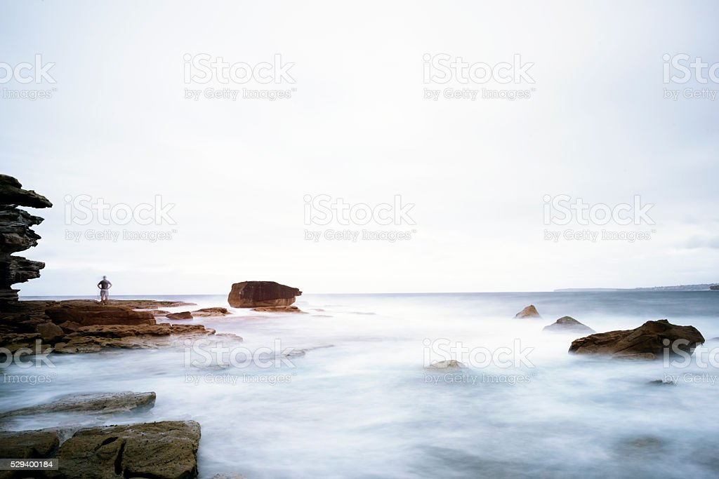 Scenic View Of Mist Over Rocks In The Sea stock photo
