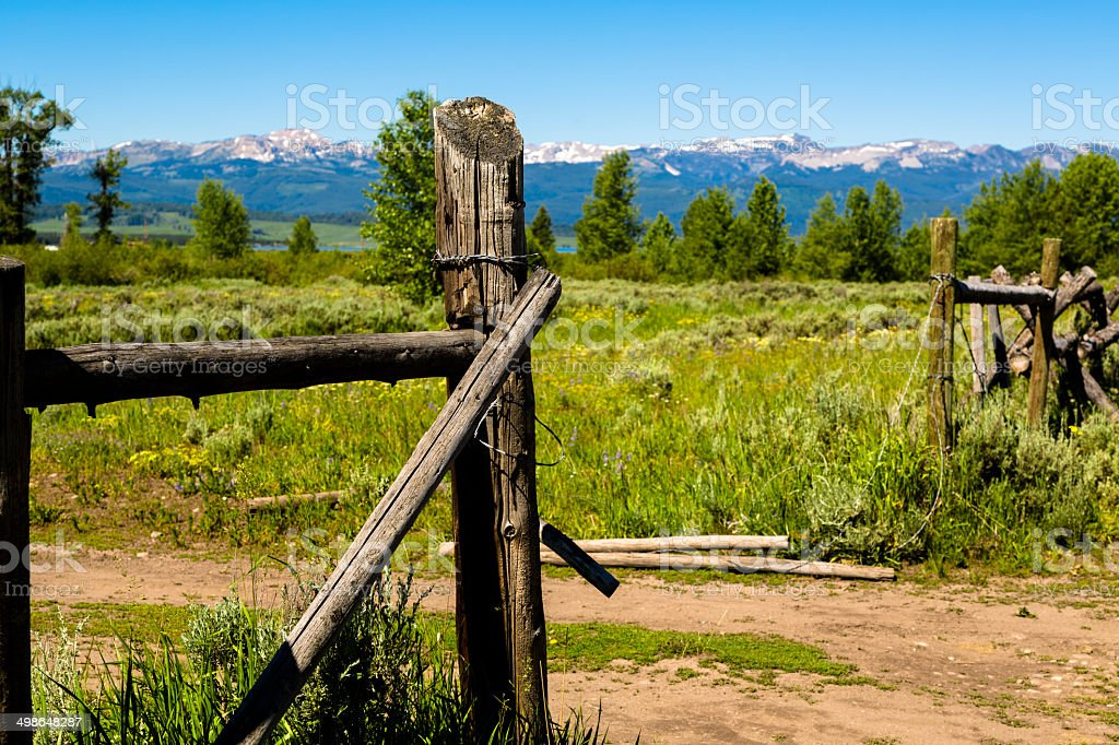 Scenic view of Montana mountains and old, wooden ranch fence. stock photo