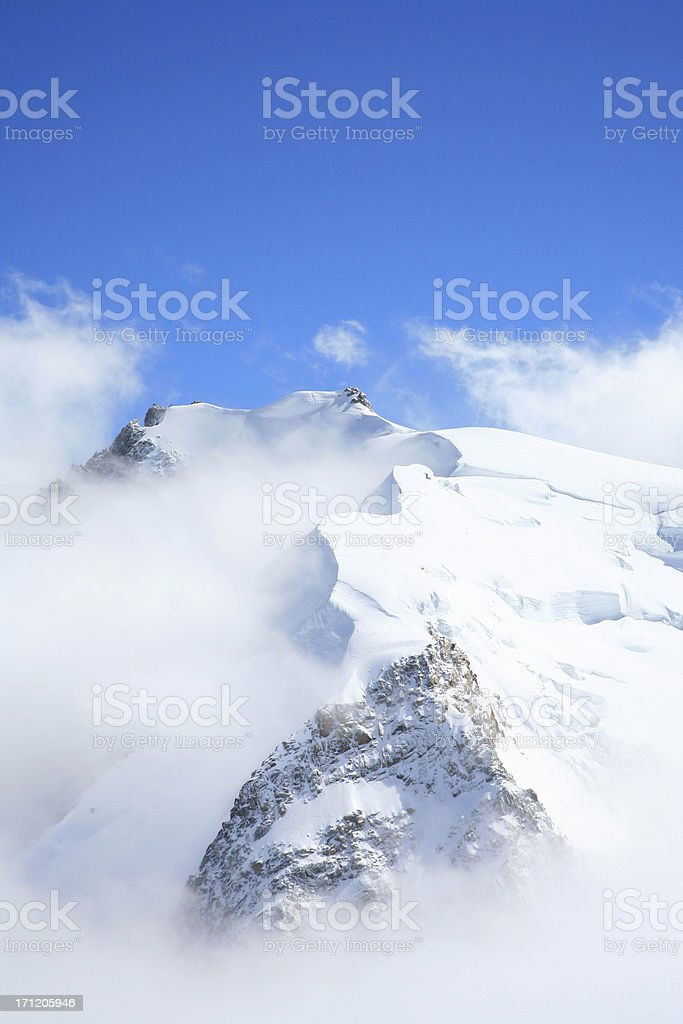Scenic view of mountain top full of snow stock photo