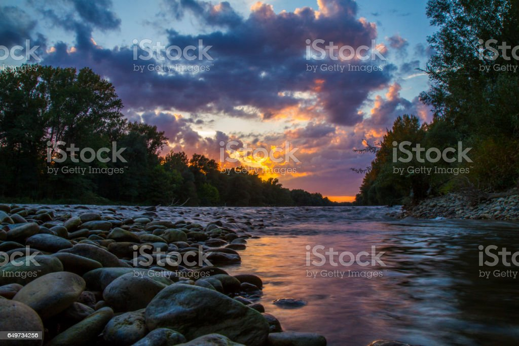 Scenic view of Mura river in forest during sunset stock photo
