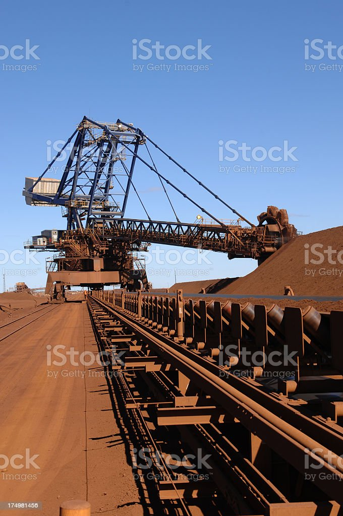 Scenic view of reclaiming machine on iron ore stockpile stock photo