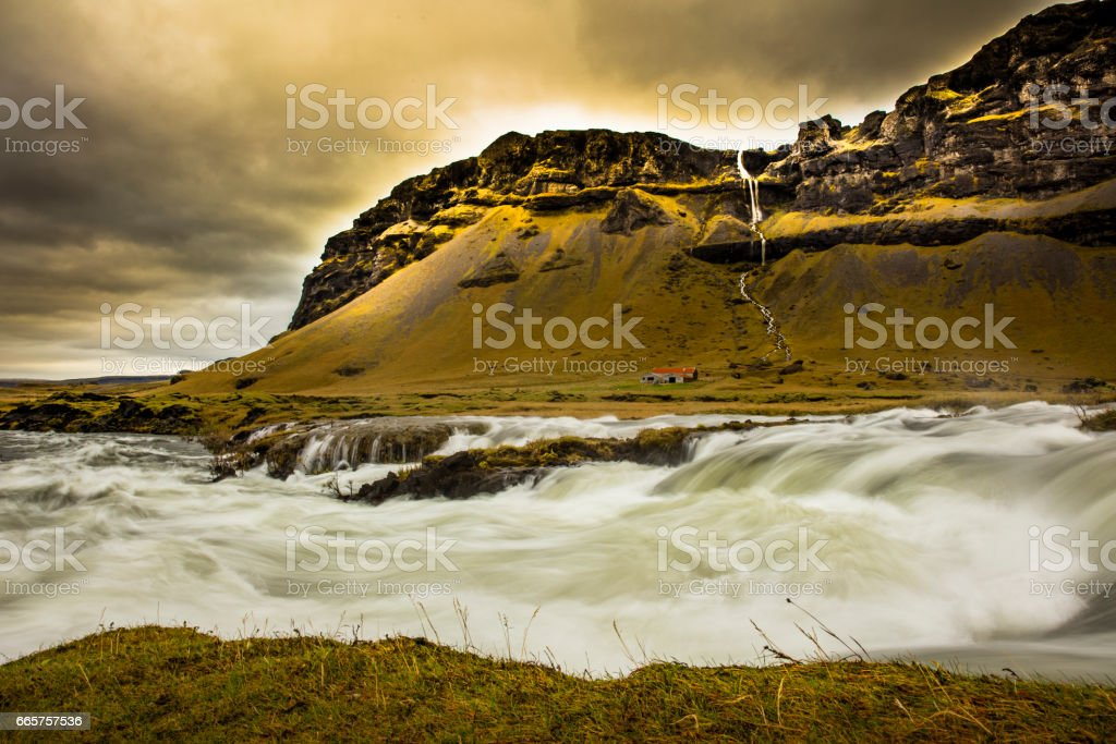 Scenic view of river flowing by mountains stock photo