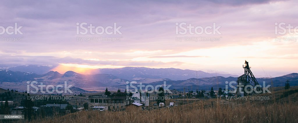 Scenic view of sunset over old western town stock photo