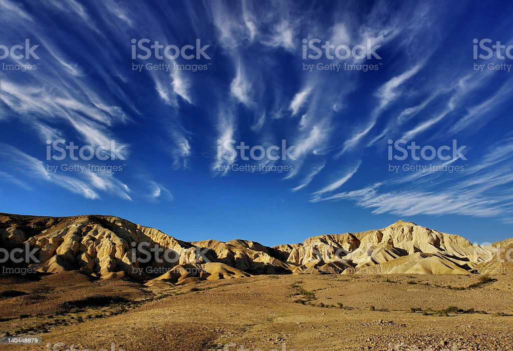 Scenic view of the arid desert under a cloud streaked sky stock photo