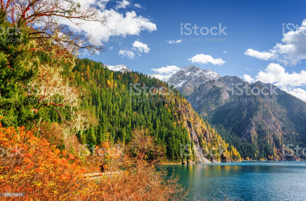 Scenic view of the Long Lake among fall woods and mountains stock photo