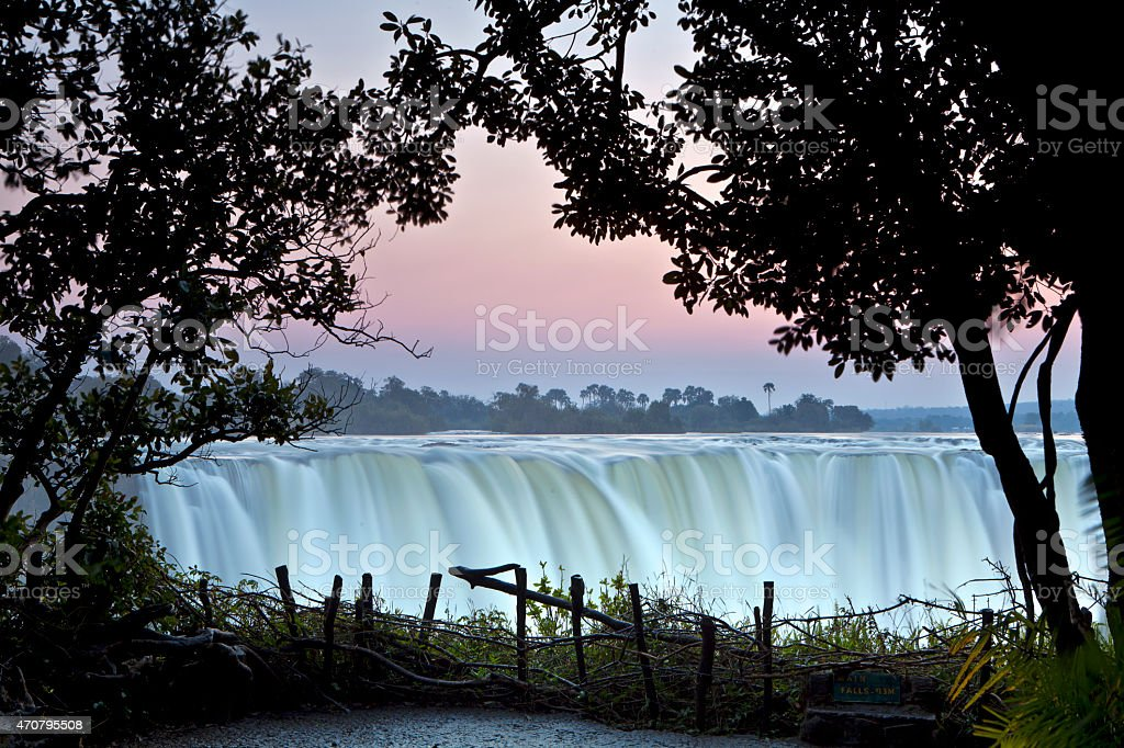 Scenic view of Victoria Falls at sunset stock photo