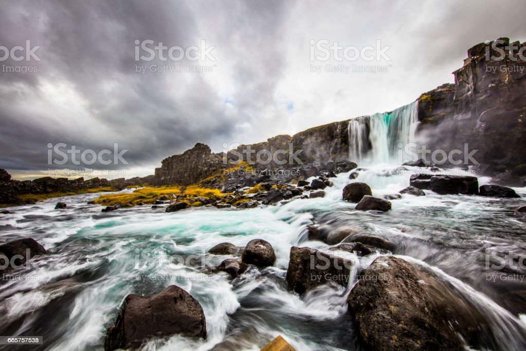 Scenic view of waterfall and river in Iceland stock photo