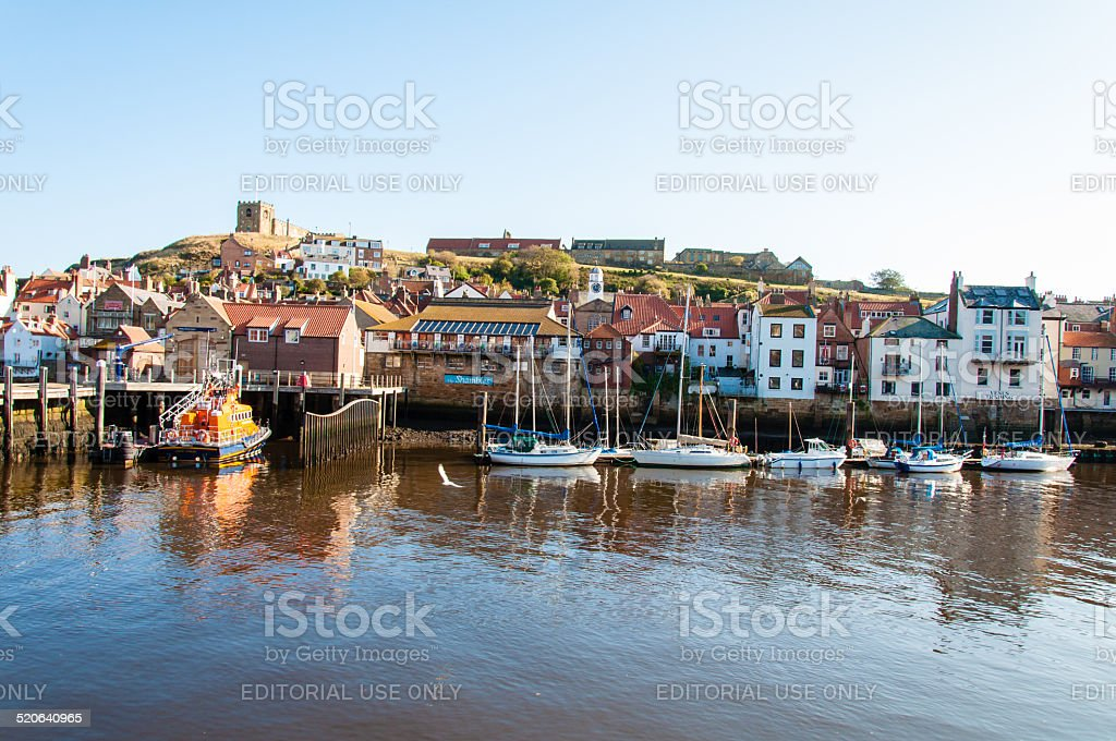 Scenic view of Whitby city and abbey in sunny day stock photo