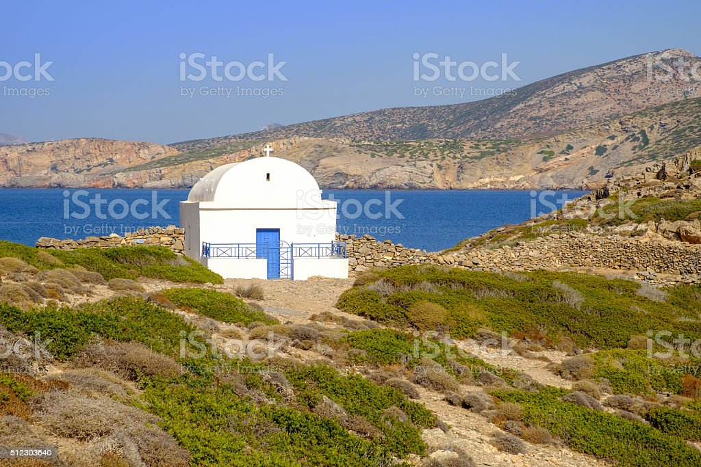 Scenic view of white chapel at beautiful ocean coastline, Greece stock photo