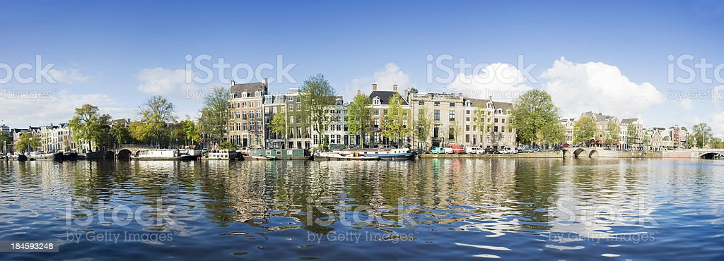 Scenic waterfront view of Amsterdam Canal. stock photo