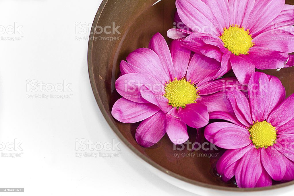 Scented massage oil in tibetan bowl. royalty-free stock photo