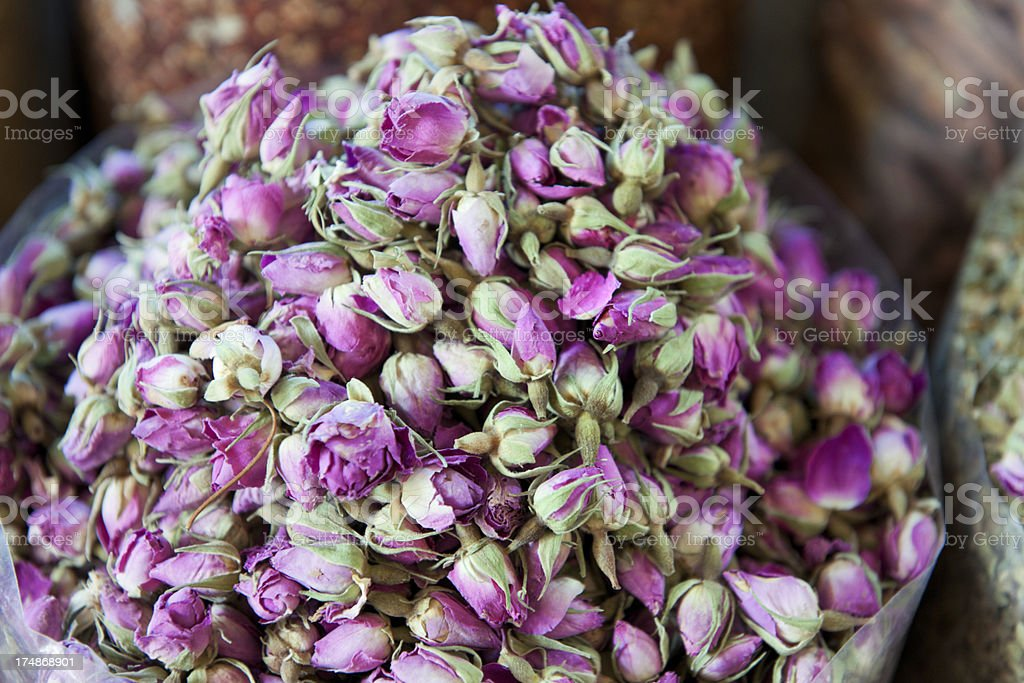 scented rose flower heads at Deira Spice Souk Dubai stock photo