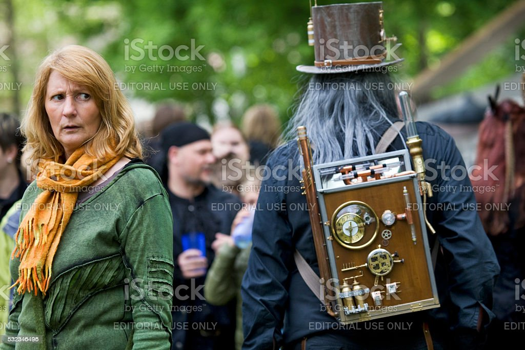 sceptical looking woman and mad scientist on WGT Leipzig stock photo