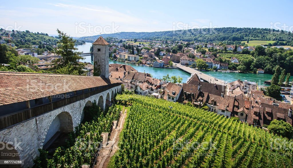 Schaffhausen, Switzerland. Panoramic view of the old town, Munot fortress overlooking Rhine River. A city on the Upper Rhine in northern Switzerland. The old town has many fine Renaissance buildings, fountains and decorations. stock photo
