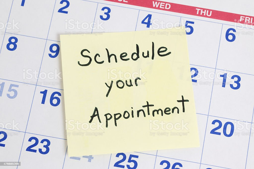 Schedule Appointment Reminder on Calendar stock photo