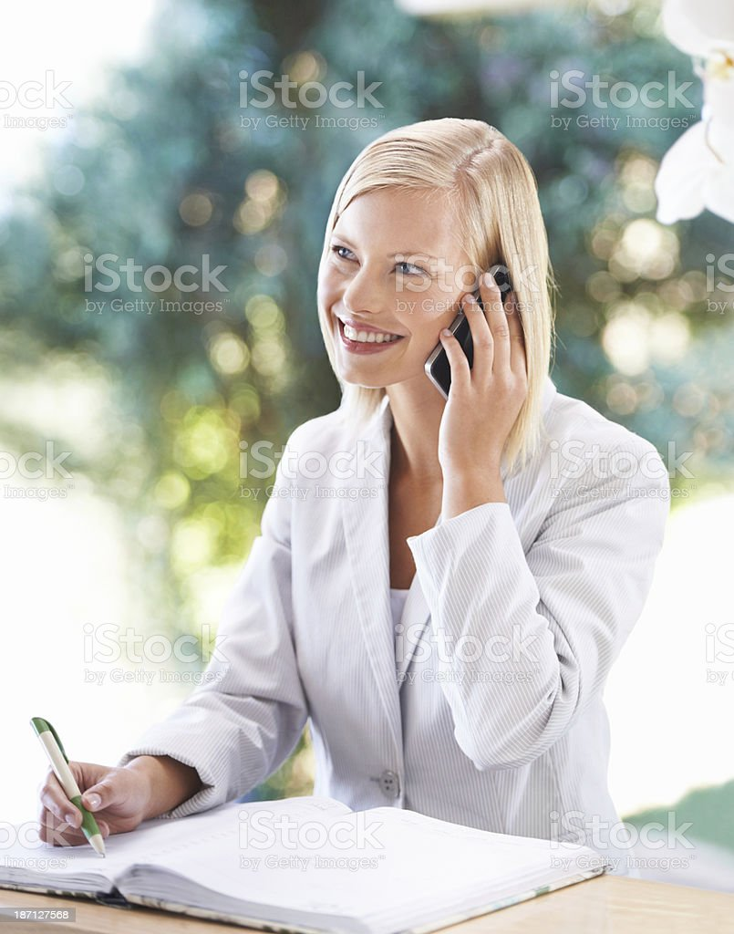 Scheduling her appointments for the day royalty-free stock photo