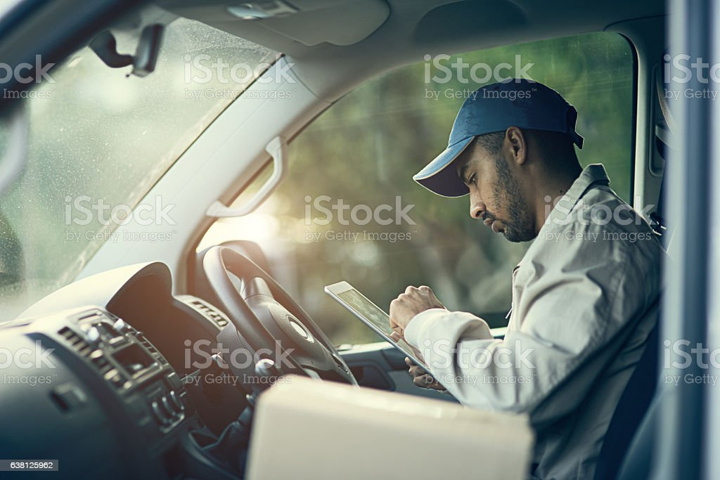 Scheduling his deliveries for the day stock photo