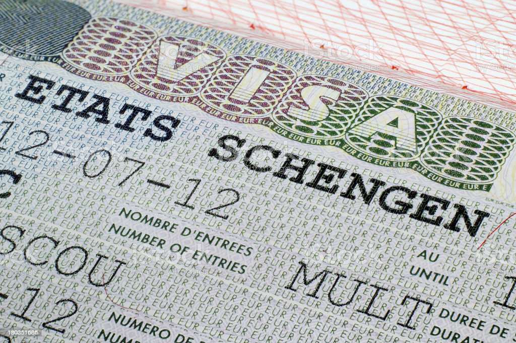 Schengen visa in passport stock photo
