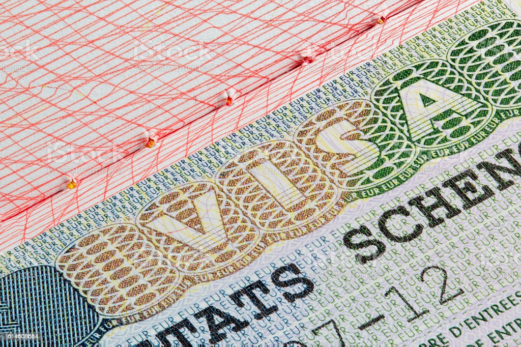 Schengen visa stamp in passport stock photo