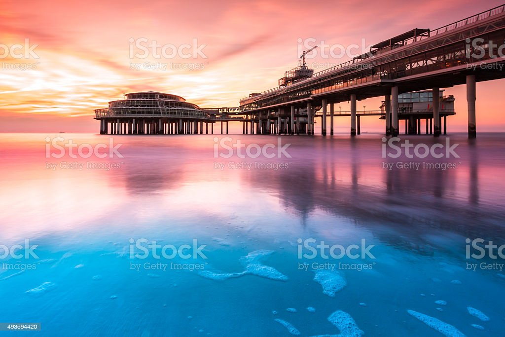 Scheveningen Pier at sunset stock photo