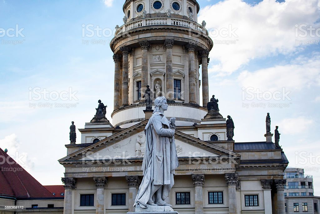 Schiller statue in front of French Cathedral in Berlin stock photo