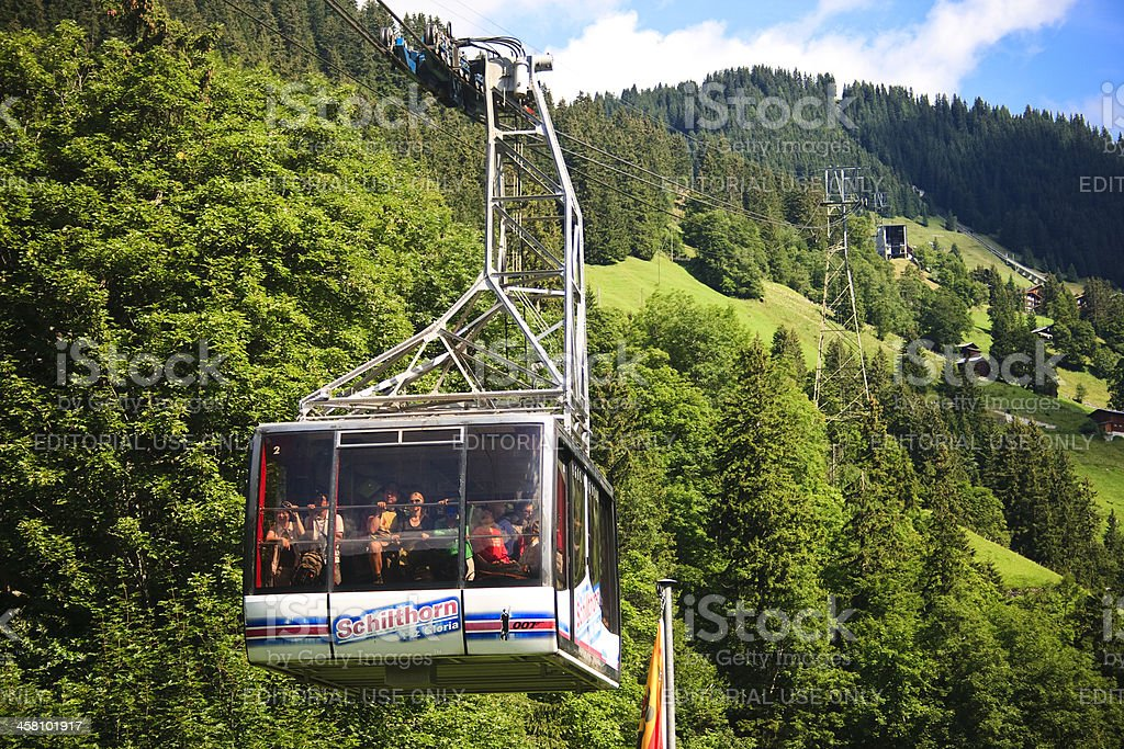 Schilthorn cable-car carries passengers from the mountain stock photo