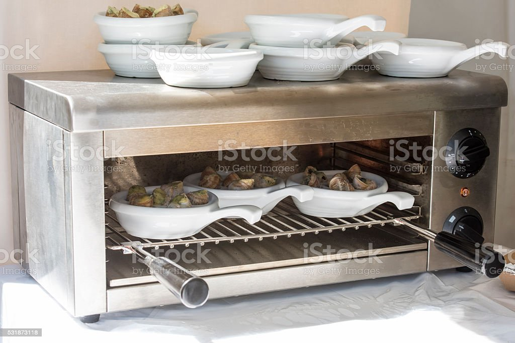 Schnecken kochen stock photo