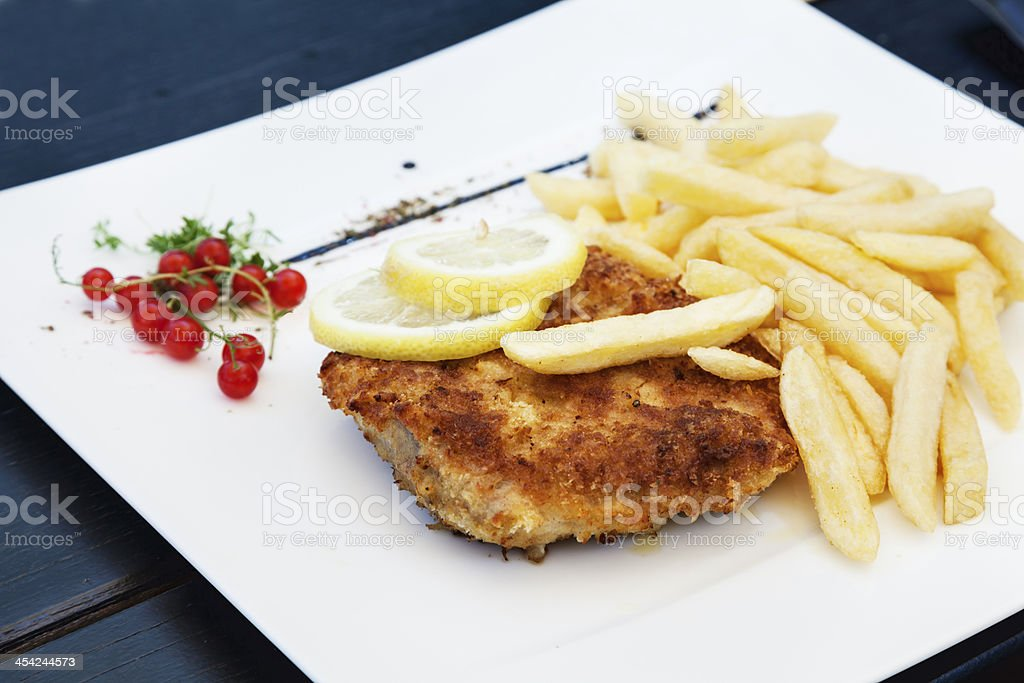 Schnitzel and french fries royalty-free stock photo