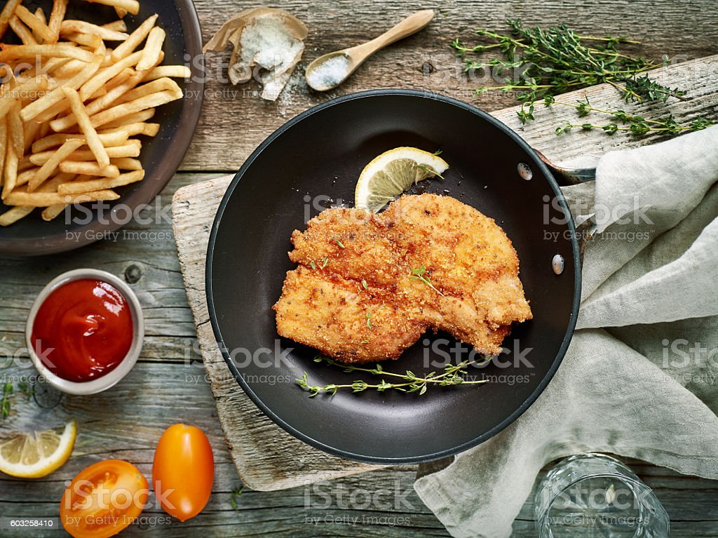 schnitzel on cooking pan stock photo