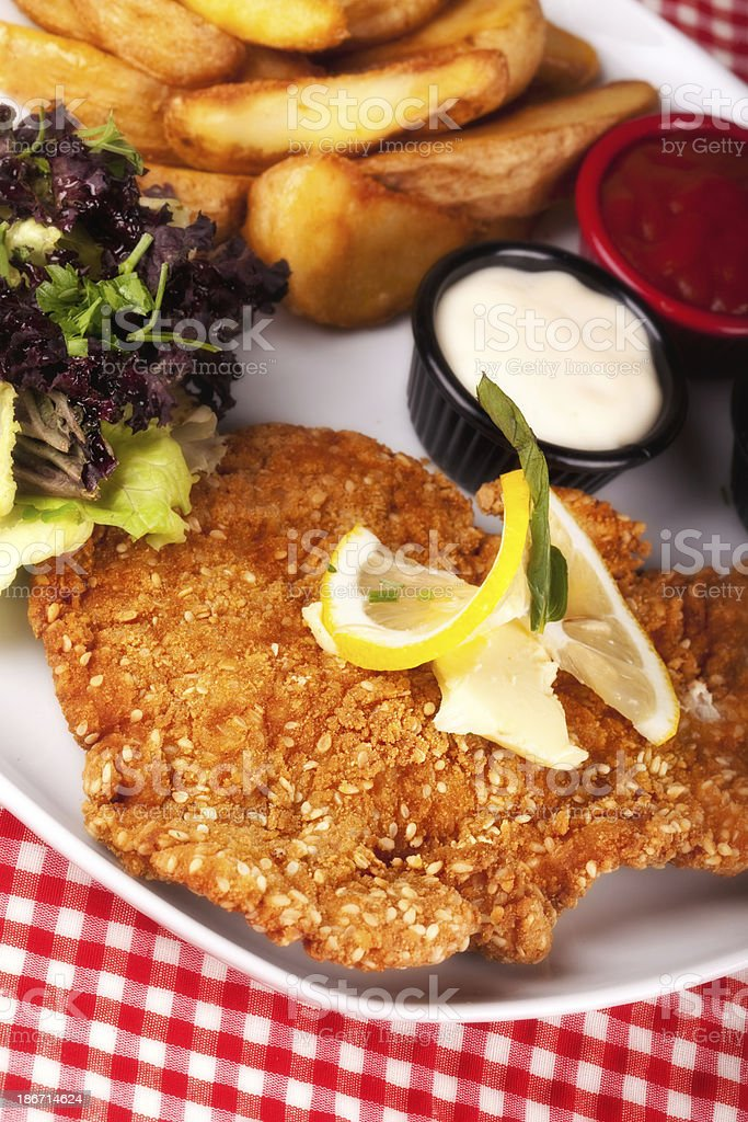 Schnitzel with french fries royalty-free stock photo