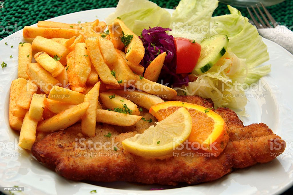 Schnitzel with french fries stock photo