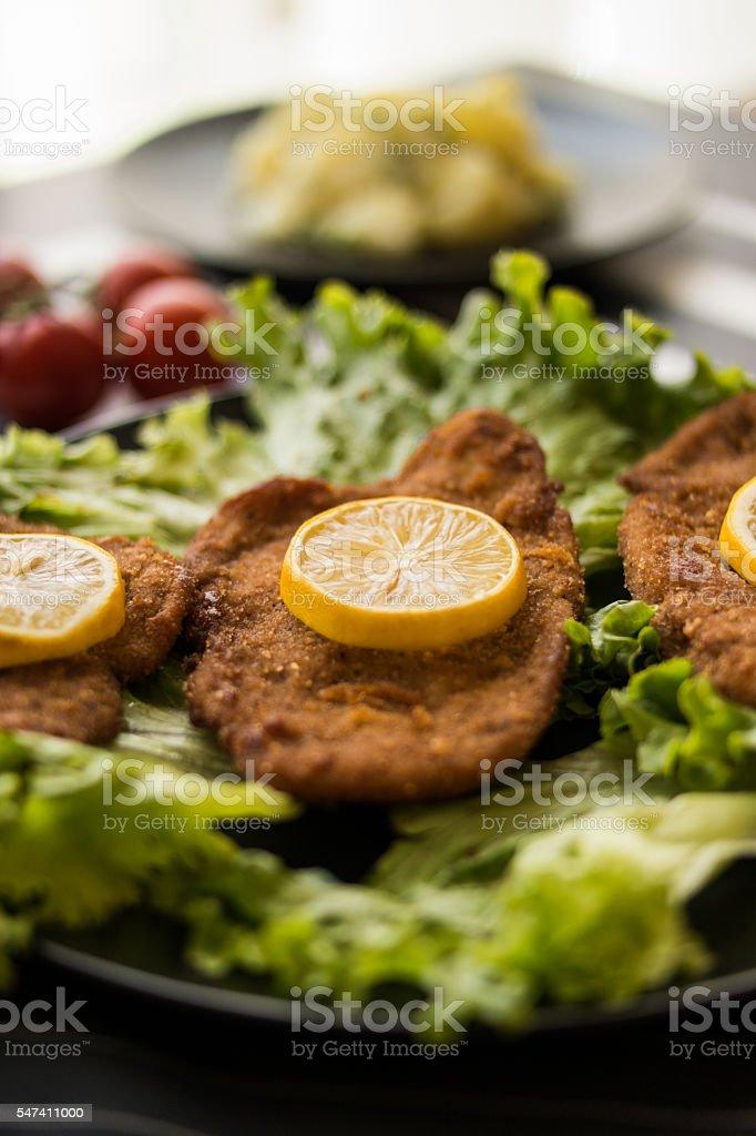 schnitzel with potato salad stock photo