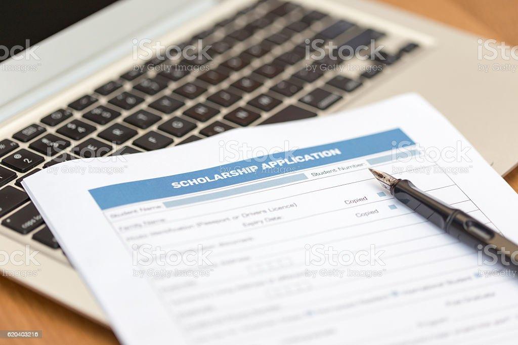 Scholarship Application Form on Desk stock photo
