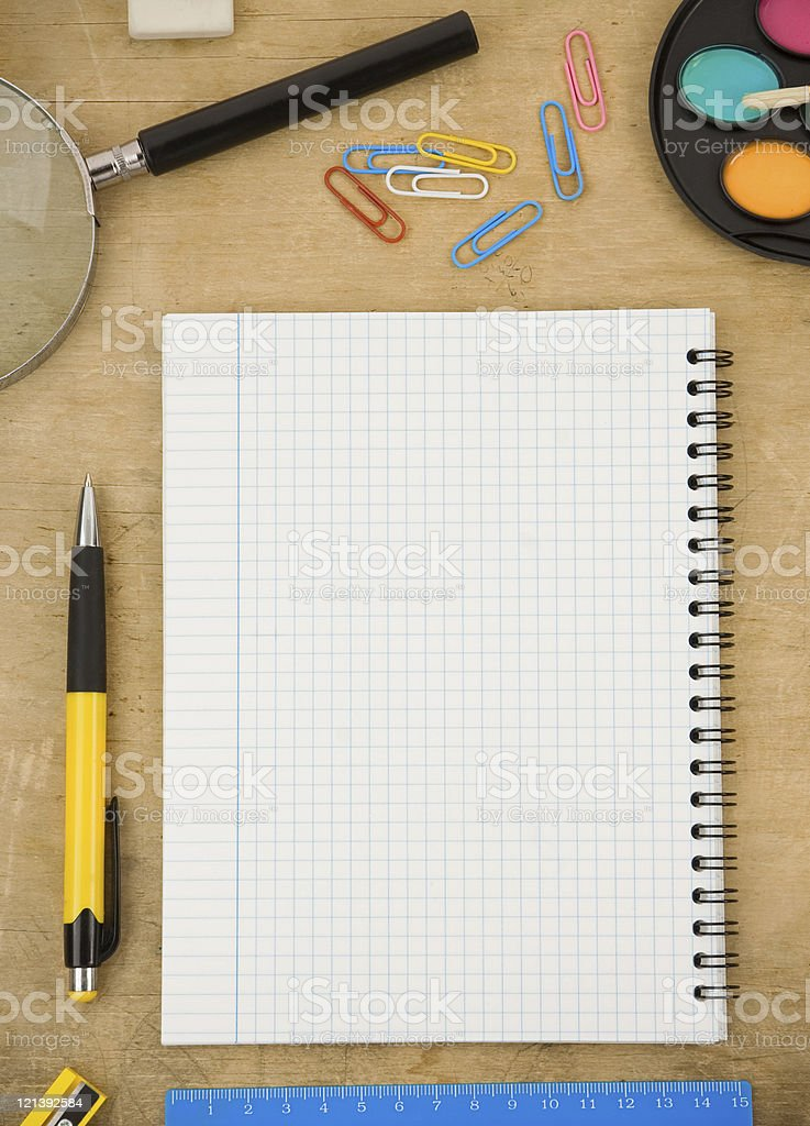 school accessories and checked notebook on wood royalty-free stock photo