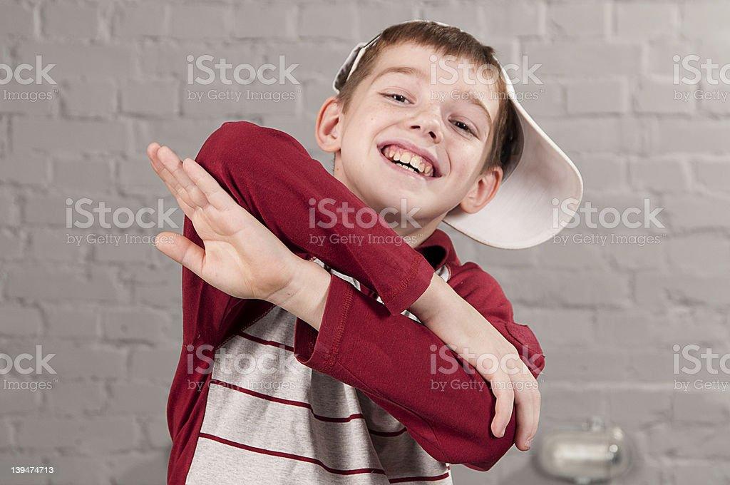 School aged boy posing like a hip hop dancer royalty-free stock photo