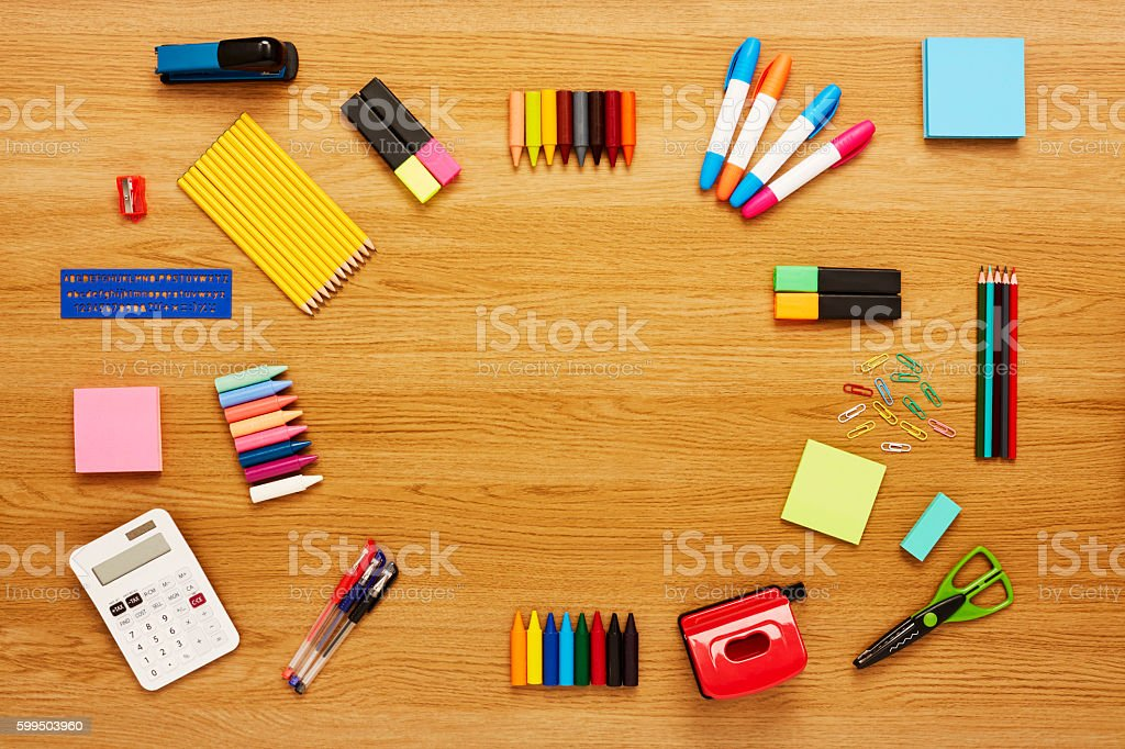 School and office supplies are arranged on wooden table stock photo