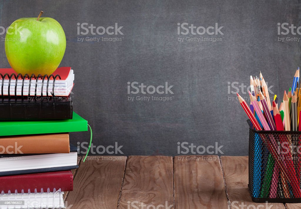 School and office supplies on classroom table stock photo