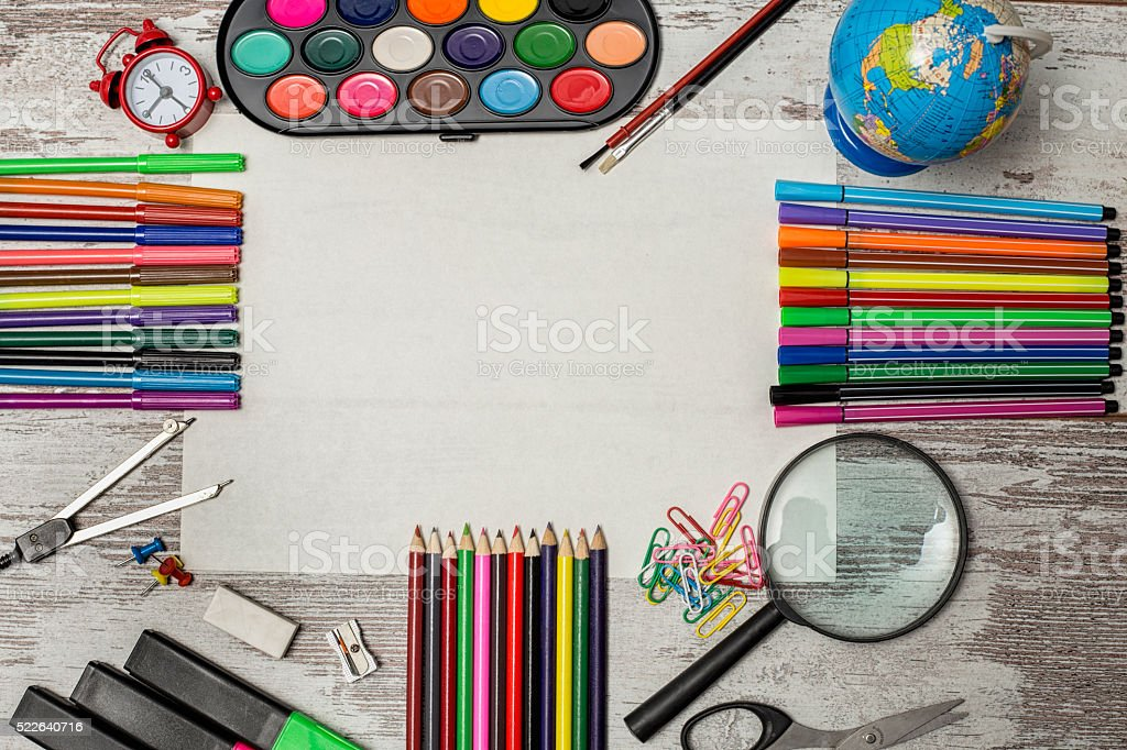 School and office supplies on wooden table stock photo